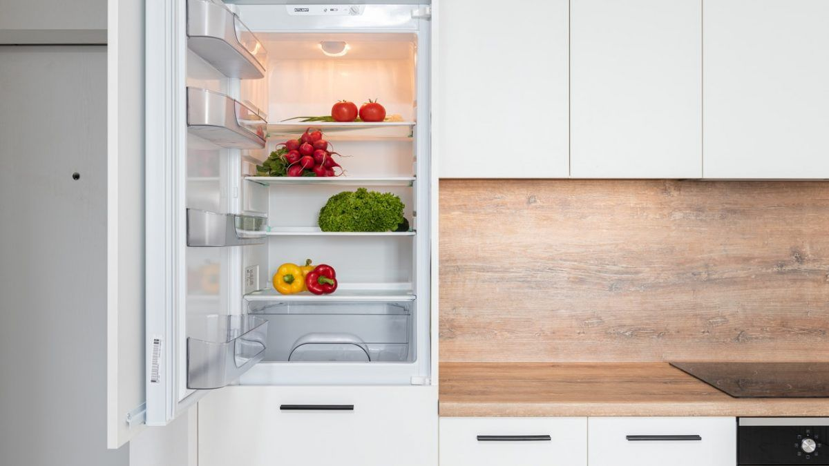 A refrigerator with vegetables in it