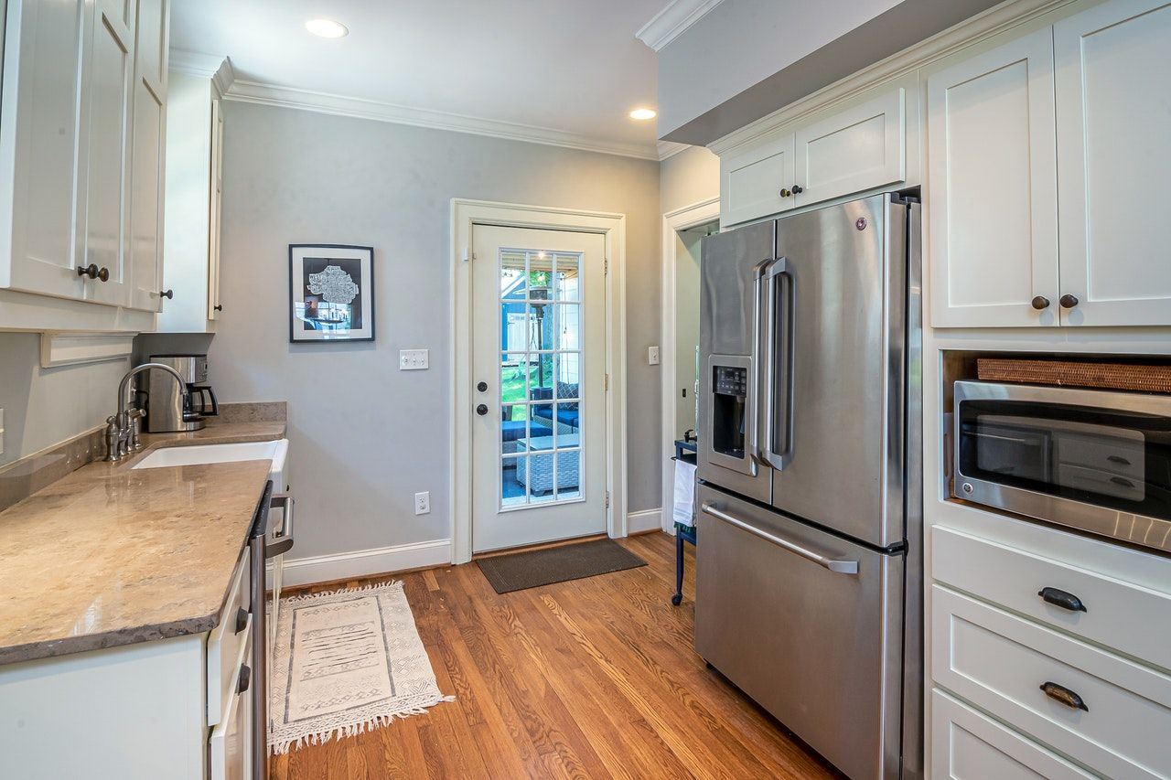 A big refrigerator in a small kitchen